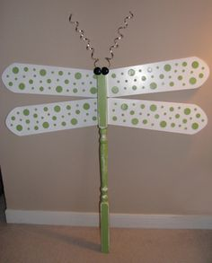 Dragonfly made with a wooden spindle and ceiling fan blades.