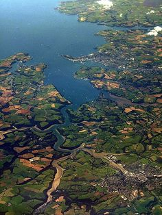 An aerial photo of Carrick Roads in Cornwall. Falmouth is at the mouth of the estuary, and Truro is in the bottom-right of the image.