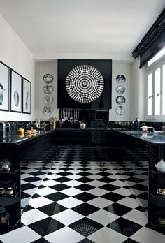 + #kitchen | The combo of checkered floor and reflective dark cupboards make the room look twice as big