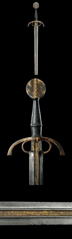 "An important sword : See Two similar models are in the Real Armeria of Madrid , see ""Catalogo de la Real Armeria"", page 211. More in Oakshot ""The Sword in the Age of Chivalry"", nr. 39C and 43., ca (15th ) century."
