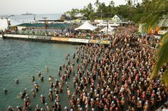 Iron Man Triathalon, Kailua Pier, Kailua~Kona, Hawaii. All these people inspire me not to sit on my arse, but to get up and TRAIN and run and DO!!!