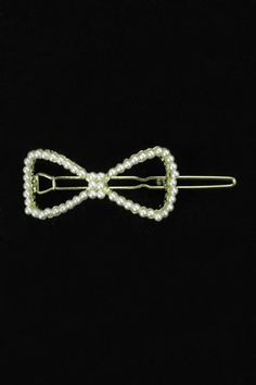 Romwe : White Pearls Bowknot Hair Clip $12.99