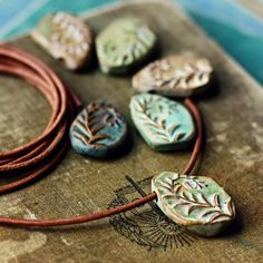 kylie parry studios: Inspired by...Costa Rica. Ceramic fiddlehead fern pendants. Organic, earthy colors.