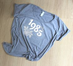 Birth Year T shirt, Womens Floral Tshirt This Lovely Softstyle deep scoop neck Gildan Tee would make a great gift for someones birthday, or you for yourself! Birth Year, Custom T, Hoodies, Sweatshirts, Button Up Shirts, Great Gifts, Shirt Designs, Scoop Neck, T Shirt