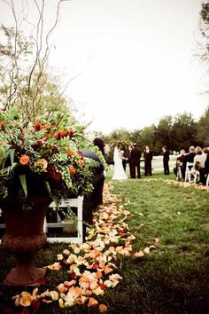 urn filled with fall flowers