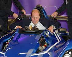 Though eager to get into the pricey vehicle William did not find it as easy to exit it as he is pictured struggling to get out