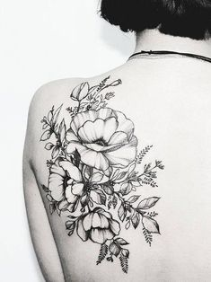 Intricate back flower tattoo. Click to discover more Sensational Flower Tattoos. #backtattoos #FlowerTattooDesigns