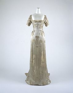 Art Nouveau Evening dress.  Quintessential Art Nouveau motIf woven into the fabric. Shown much higher on board in close detail without mannequin.