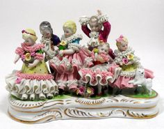 Dresden porcelain figural group of children and a small dog on a gilt decorated base. Measures 8 1/2''L X 6''H. For shipping and insurance quotes please call Ryan or Dave at Eagle Shipping Center 561-932-0700 or email them at ryan@eagleshippingcenter.com