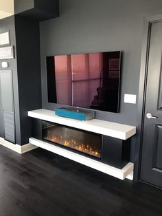 37 Chic Electric Fireplace Tv Stand Design Ideas For Your Family Room Living Room Tv, Living Room With Fireplace, Dining Room, Tv Wall Design, House Design, Tv Above Fireplace, Tv Stand With Fireplace, Fireplaces With Tv Above, Bioethanol Fireplace