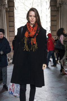 Shop this look for $70:  http://lookastic.com/women/looks/orange-scarf-and-black-overcoat-and-black-skinny-jeans/1208  — Orange Print Scarf  — Black Overcoat  — Black Skinny Jeans