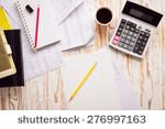 Top view calculator and paper, cup of coffee, pencils and eraser on  white wooden table.Concept for Financial accounting  - stock photo
