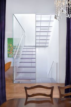 Ecorsein by 3Form transparent stairs function as lightwell. Dwell.