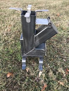 This Stainless steel accessorized Rocket Stove is just one of the custom, handmade pieces you'll find in our fire pits shops. Rocket Stove Design, Diy Rocket Stove, Rocket Stoves, Welding Crafts, Welding Art Projects, Metal Projects, High Heat Paint, Expanded Metal Mesh, Multi Fuel Stove