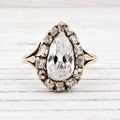 1.42 Carat Pear Shaped Diamond Antique Engagement Ring | New York Vintage & Antique Estate Jewelry. Front view of the band.