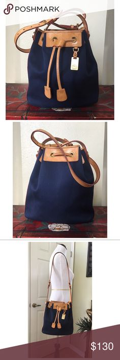 """VINTAGE DOONEY AND BOURKE CABRIOLET DRAWSTRING BAG Vintage D&B Navy Blue Cabriolet Fabric & Leather drawstring Bag.  In great condition.  There are water marks on the leather.  Interior and exterior are very clean.  2 interior slip pockets, drawstring closure.  ALL MEASUREMENTS ARE APPROXIMATE: 10.5"""" W X 10.75"""" H X 5.0"""" D ADJUSTABLE SHOULDER STRAP 14.0""""- 18.0"""" Dooney & Bourke Bags Shoulder Bags"""