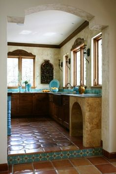Love the details above kitchen windows,  the scones and talavera on the step