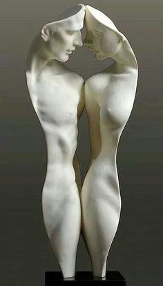 Sculpture of a man and woman in comparison.