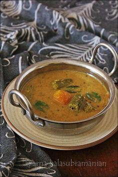 """Sambhar is frequently prepared and served in Palakkad Iyer homes. It is usually eaten mixed with rice, along with a dry vegetable preparation on the side, as the first part of the main meal. Of course, it also accompanies idli,dosai and sometimes vadai (deep-fried savoury black gram lentil snacks) The """"Varatha"""" in the first word of this post title means """"fried"""" and Araitcha"""" means """"ground to a paste"""". This refers to the spices and coconut, which are fried/ roasted in very little oil and…"""