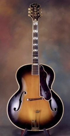 """1940 Epiphone Emperor archtop in good condition. maple body, laminated neck w/ pearl V-block fingerboard inlays and pearl flower/vine headstock inlay. All-original, including Kolb """"E"""" . Epiphone Acoustic Guitar, Custom Acoustic Guitars, Archtop Guitar, Jazz Guitar, Guitar Art, Guitar Collection, Gibson Guitars, Flowering Vines, Emperor"""