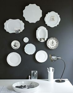 White dishes on a black wall. Quite stunning.