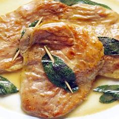 Veal Saltimbocca  Ingredients 1 pound veal leg cutlets, cut 1/8 to 1/4 inch thick 1/4 tsp ground white pepper 1 Tbs thinly sliced fresh sage 2 oz thinly sliced prosciutto, cut to fit cutlets 1-1/2 Tbs unsalted butter 1/4 cup diced seeded tomato 2 oz shaved Parmesan cheese   Sauce 1/3 cup dry white wine 1 tsp minced fresh sage