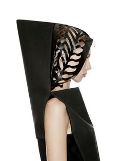 Sculptural Fashion - hooded black dress with strong lines, 3D silhouette and laser cut leather detail // DZHUS