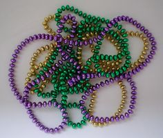 New Orleans Photo: Mardi Gras Beads New Orleans Mardi Gras, Mardi Gras Beads, Baby Cartoon, Baby Socks, Beaded Bracelets, Pure Products, Wool, Fans, Gallery