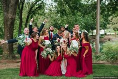 Fun bridal party photography, bridesmaids and groomsmen celebrating around couple as they kiss