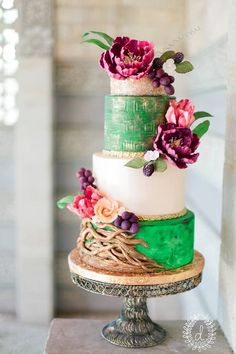Wedding cakes often act as centerpieces to a wedding reception and match the other colors featured in a wedding. These weddings cakes are not only colorful, but they feature accents that make them unique. The bright colors and interesting details on these cakes will be sure to inspire and provide a striking centerpiece to your wedding! […]