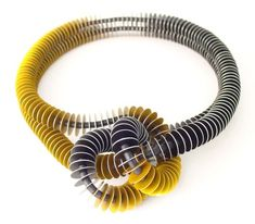 [fblike]  [col3] Biography Award winning contemporary jewellery artist, John Moore, creates his unique pieces of wearable sculpture from brightly coloured aluminium, silver and steel. With a…