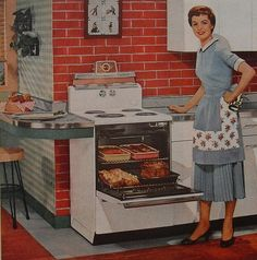 1950s housewife in kitchen interior