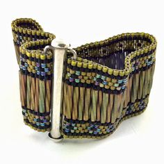 Handwoven Cuff Bracelet with Black and Gold Miyuki Delica and Bugle Beads. This bracelet is handwoven one bead at a time not on a loom. Beaded Braclets, Beaded Bracelet Patterns, Woven Bracelets, Seed Bead Bracelets, Seed Bead Jewelry, Jewelry Patterns, Beaded Earrings, Beaded Jewelry, Handmade Jewelry