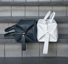 Leather Cube Bag Cube shaped leather bag! Great features: Closes with a zipper Detachable shoulder strap Mini cube inside Keychain Measurements: