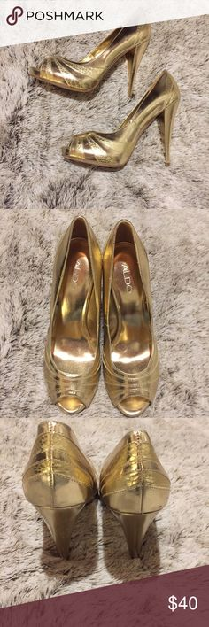 Aldo Gold Peep Toe Heels Size 40. Good Condition. Heel height is 5 inches. Does have some wear on the shoes. As seen in pictures but have lots of life left in them! Aldo Shoes Heels