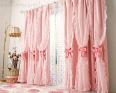 Adorable.  Ruffled frilly pink curtains.