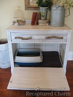 Old furniture turned into a cat litter box.....holder....clever.  My mother-in-law would love this...