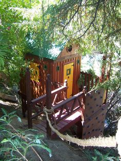 To access this treehouse, start by sliding down this steep embankment with the help of a tree rope. BarbaraButler.com