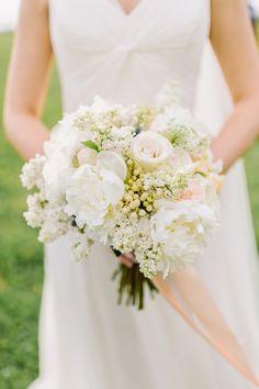 all-white bouquet, photo by L. Hewitt Photography http://ruffledblog.com/19th-century-stone-house-inspiration #flowers #weddingbouquet