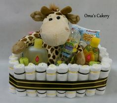 Basket contains: -Size 1 Diapers -Giraffe Stuffed Animal -Giraffe Rattler -Giraffe Bottle -Baby Wipes -Baby Shampoo -Head to Toe Wash -Baby Lotion -Diaper Rash Ointment -(2) Wash Cloths -(2) Spoons (Ribbon is brown & yellow)