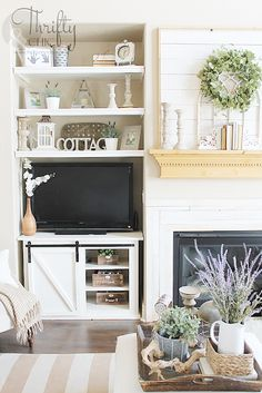 Farmhouse style living room decor and decorating ideas. Cottage style living room inspiration. Fixer upper style living room. Two story living room ideas. Two story great room decor. spring mantel decor