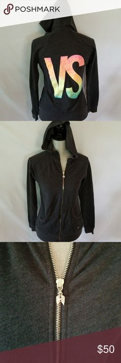 Victoria's Secret jacket Dark gray hoodie zip up jacket. Has silver angel wings on zipper and on bottom of jacket in front. Beautiful sequin bright VS on back Victoria's Secret Jackets & Coats