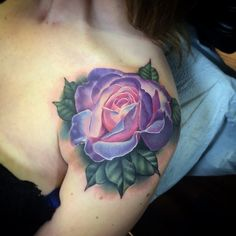 A gorgeous shoulder cap rose tattoo by Kyle Wood. I love the purple-blue colors and the translucent style