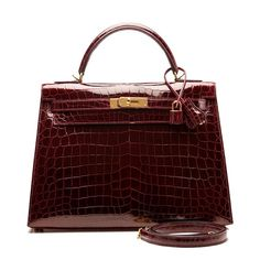 Hermes Bordeaux Shiny Niloticus Crocodile Kelly Sellier 32cm |... ($62,000) ❤ liked on Polyvore featuring bags, handbags, crocodile purse, crocs bag, red handbags, crocodile bag and hermes bag