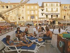 Holidaymakers on the deck of a yacht, St Tropez, 1971 Photo Slim Aarons/ Getty Images