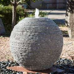 """The unique water flow on this outdoor fountain is created by the irregular """"broken"""" saw cut texture. The ribbed sphere fountain is available in several sizes. Stone Garden Fountains, Garden Spheres, Garden Stones, Outdoor Fountains, Garden Pond, Garden Planters, Broken Concrete, Concrete Garden, Garden Features"""