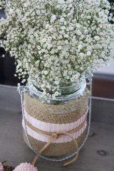 wildflowers/babys breath and burlap wraps on mason jars for decor.