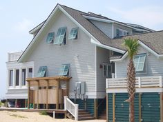 Living in hurricane zones doesn't mean you have to sacrifice style for security. Try installing stylish, retractable shutters to protect your windows and doors when bad weather strikes. Types Of Shutters, Red Shutters, Interior Shutters, Bermuda Shutters, Bahama Shutters, Exterior Colors, Exterior Paint, Exterior Windows, Exterior Siding