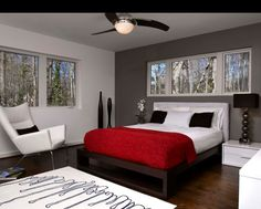 With the perfect color scheme White funiture pieces could accent the mahogany bed giving a sleek and mondern look...