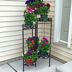 The Sunnydaze Decor 6 Tiered Folding Plant Stand is going to create a bit of height and drama on your porch or in your living room. This three-sided. Front Porch Plants, Front Yard Decor, Small Front Porches, Front Yard Landscaping, Deck Patio, Farmhouse Landscaping, Outside House Decor, Outdoor Landscaping, Landscaping Ideas